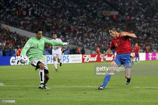 Fernando Torres of Spain scores his team's second goal past Goalkeeper Ali Boumnijel of Tunisia during the FIFA World Cup Germany 2006 Group H match...