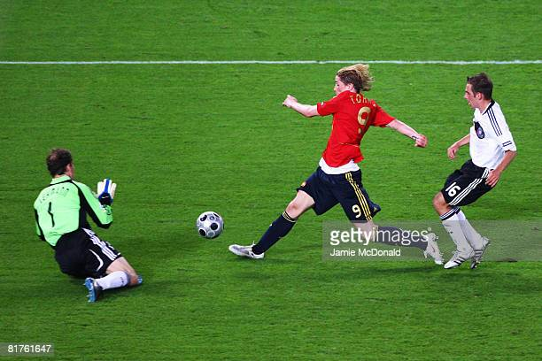 Fernando Torres of Spain scores the opening goal during the UEFA EURO 2008 Final match between Germany and Spain at Ernst Happel Stadion on June 29...