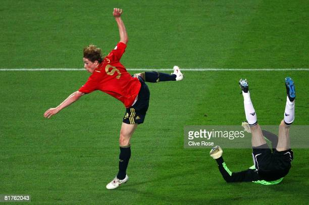 Fernando Torres of Spain scores the opening goal past German goalkeeper Jens Lehmann during the UEFA EURO 2008 Final match between Germany and Spain...