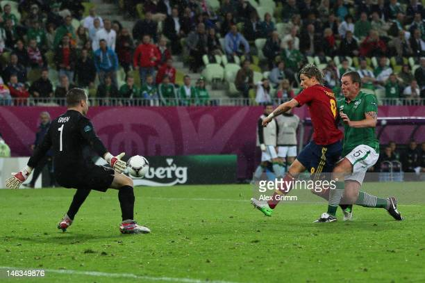 Fernando Torres of Spain scores their third goal during the UEFA EURO 2012 group C match between Spain and Ireland at The Municipal Stadium on June...