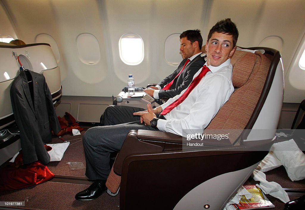 Fernando Torres (R) of Spain sits flanked by Xabi Alonso shortly after touch down at Johannesburg airport on June 11, 2010 in Johannesburg, South Africa.