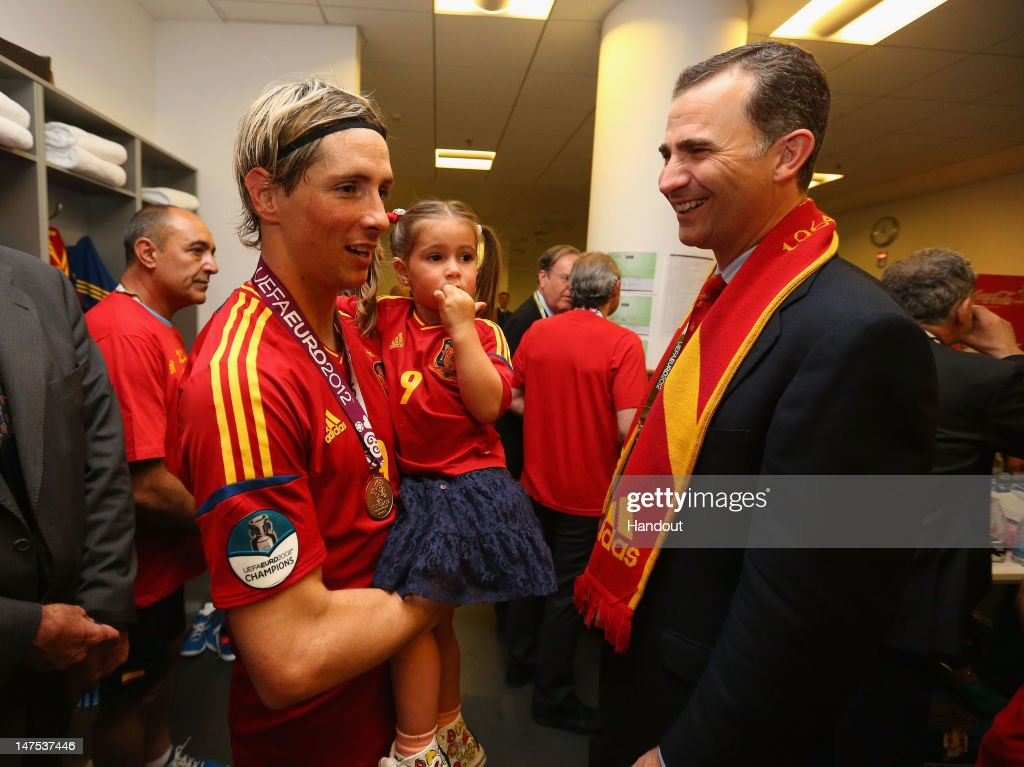 Fernando Torres of Spain speaks to Prince Felipe of Spain in the dressing room following the UEFA EURO 2012 final match between Spain and Italy at the Olympic Stadium on July 1, 2012 in Kiev, Ukraine.