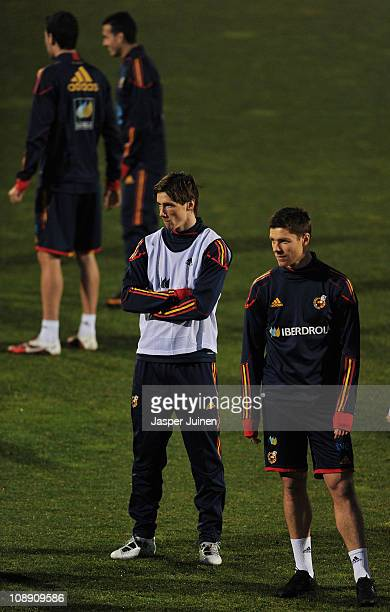 Fernando Torres of Spain stands besides his teammate Xabi Alonso during a training session ahead of Wednesday's friendly match against Colombia on...