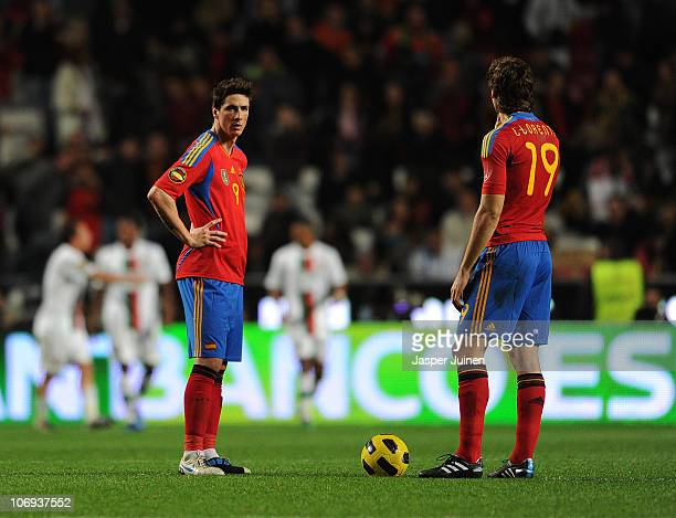 Fernando Torres of Spain stands dejected with his teammate Fernando Llorente after conceding their third goal during the International Friendly match...