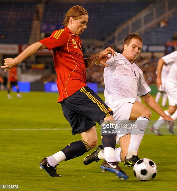 Fernando Torres of Spain tries to get past a US defender during a friendly International soccer match at El Sardinero stadium on June 4 2008 in...
