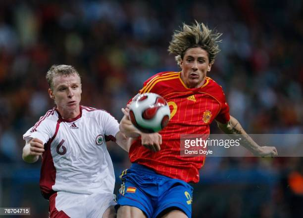 Fernando Torres of Spain vies for the ball with Deniss Ivanovs of Latvia during the UEFA Euro 2008 group F qualifier between Spain and Latvia at the...