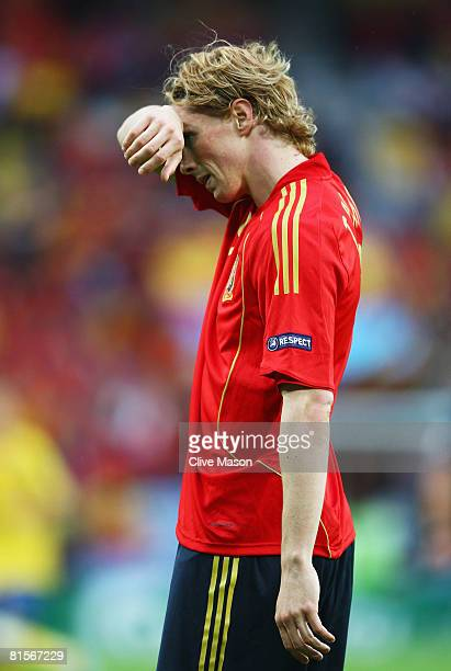 Fernando Torres of Spain wipes his forehead during the UEFA EURO 2008 Group D match between Sweden and Spain at Stadion Tivoli Neu on June 14 2008 in...