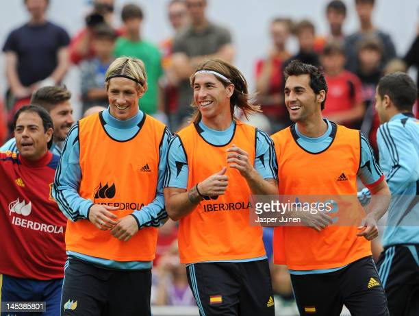 Fernando Torres , Sergio Ramos and Alvaro Arbeloa of Spain smile as they excercise during a training session on May 28, 2012 in Schruns, Austria.