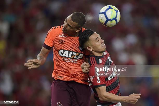 Fernando Uribe of Flamengo struggles for the ball with Ze Ivaldo of AtleticoPR during the match between Flamengo and AtleticoPR as part of...