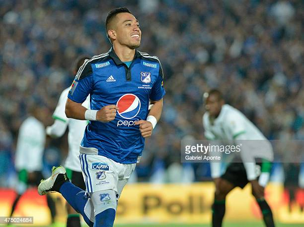 Fernando Uribe of Millonarios celebrates after scoring the second goal of his team during a first leg match between Millonarios and Deportivo Cali as...