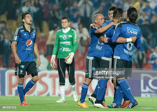 Fernando Uribe of Millonarios celebrates with teammates after scoring the second goal of his team during a match between Millonarios and Deportivo...
