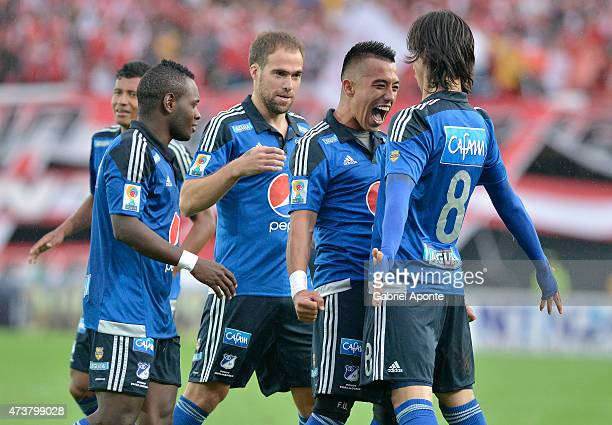 Fernando Uribe of Millonarios celebrates with teammates after scoring during a match between Independiente Santa Fe and Millonarios as part of 20th...