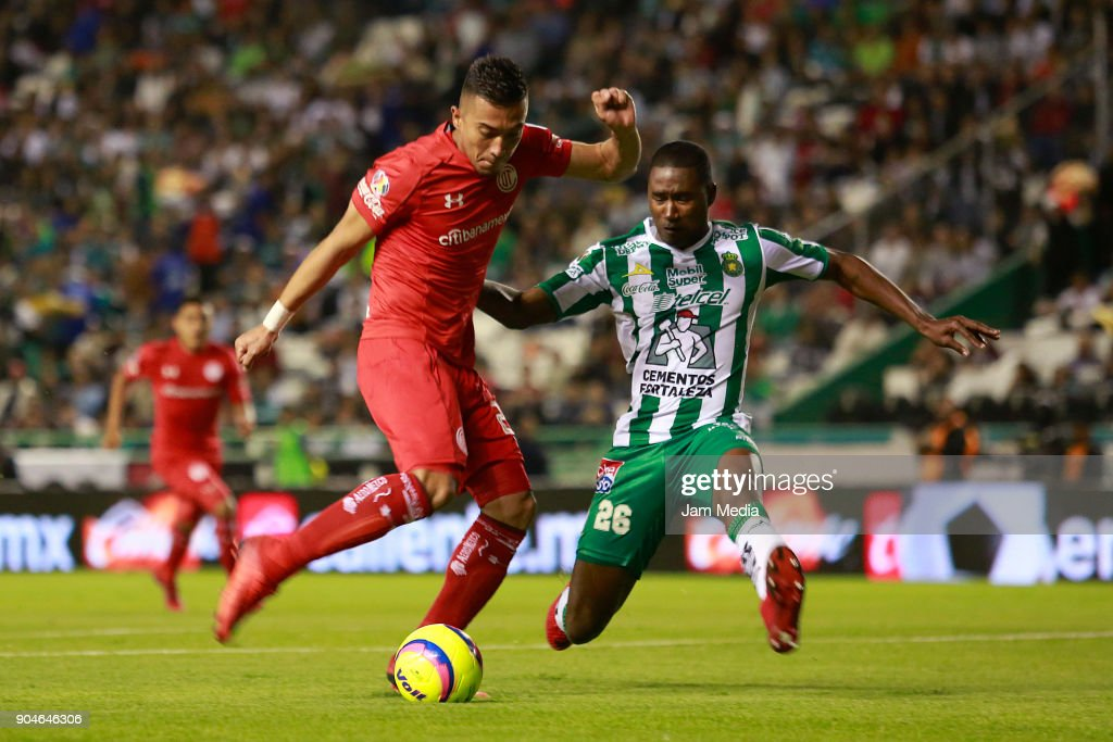 Fernando Uribe (L) of Toluca and Andres Mosquera (R) of Leon fight for the ball during the second round match between Leon and Toluca as part of the Torneo Clausura 2018 Liga MX at Leon Stadium on January 13, 2018 in Leon, Mexico.