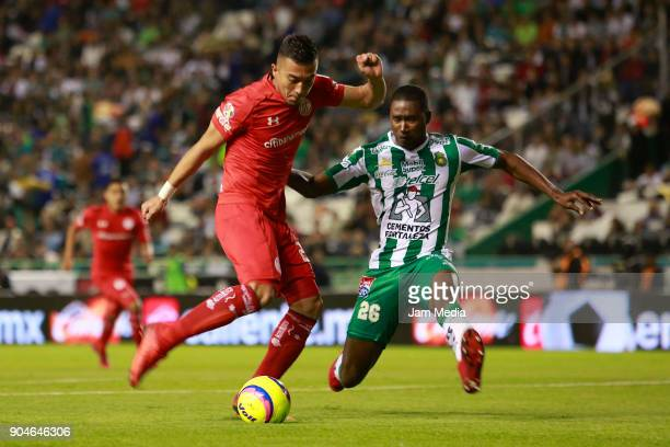 Fernando Uribe of Toluca and Andres Mosquera of Leon fight for the ball during the second round match between Leon and Toluca as part of the Torneo...