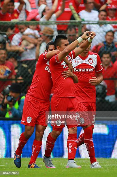 Fernando Uribe of Toluca celebrate with teammates after scoring the third goal of his team during a 5th round match between Toluca and Chivas as part...