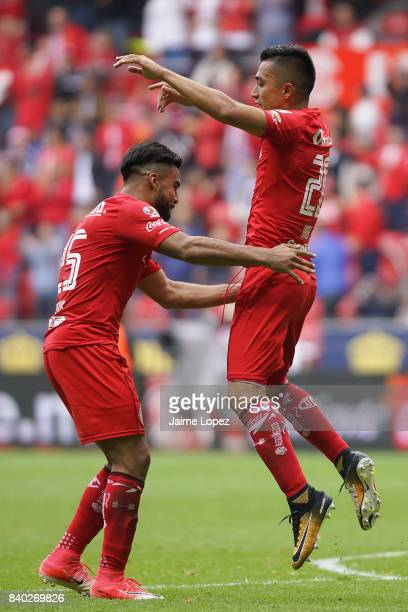 Fernando Uribe of Toluca celebrates with teammate Pedro Alexis Canelo after scoring the second goal of his team during the seventh round match...