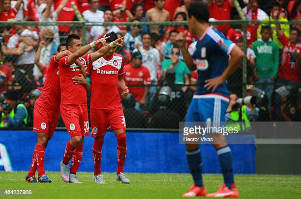 Fernando Uribe of Toluca celebrates with teammates after scoring the third goal of his team during a 5th round match between Toluca and Chivas as...