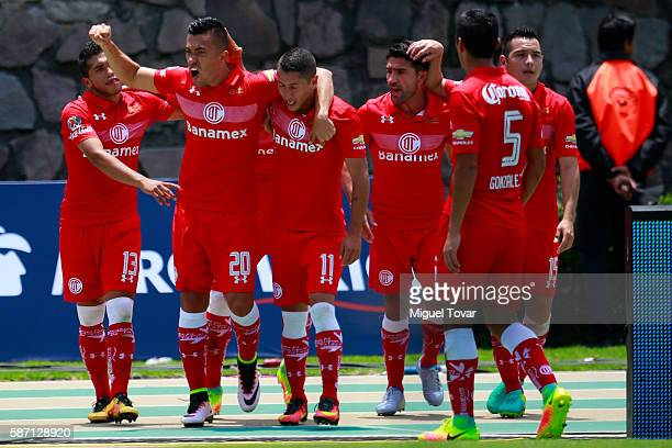 Fernando Uribe of Toluca celebrates with teammates after scoring during the 4th round match between Toluca and Pachuca as part of the Torneo Apertura...