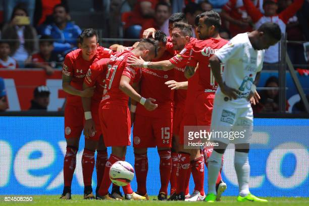 Fernando Uribe of Toluca celebrates with teammates after scoring the second goal of his team during the 2nd round match between Toluca and Leon as...