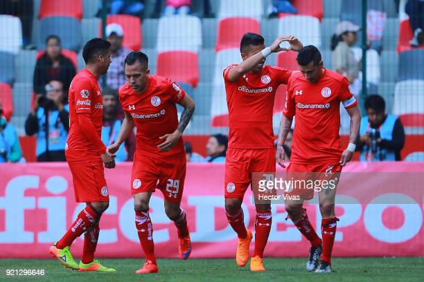Fernando Uribe of Toluca celebrates with teammates after scoring the second goal of his team during the 8th round match between Toluca and Santos...
