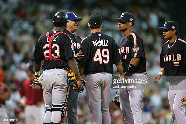 Fernando Valenzuela of the World team pays a visit to the mound to talk to players Robinzon Diaz Arnaldo Munoz Robinson Cano and Andres Blanco during...