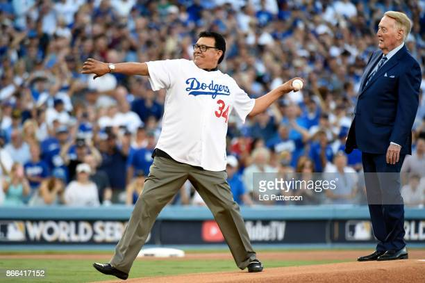 Fernando Valenzuela throws the ceremonial first pitch as Vin Scully looks on during Game 2 of the 2017 World Series between the Houston Astros and...