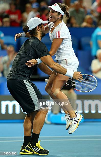 Fernando Verdasco and Anabel Medina Garrigues of Spain celebrate after defeating Novak Djokovic and Ana Ivanovic of Serbia in the mixed doubles final...