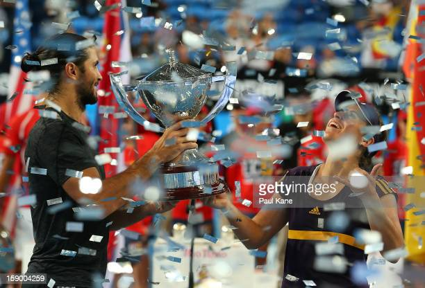 Fernando Verdasco and Anabel Medina Garrigues of Spain celebrate with the trophy after defeating Novak Djokovic and Ana Ivanovic of Serbia in the...