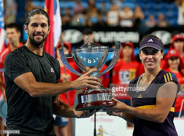 Fernando Verdasco and Anabel Medina Garrigues of Spain pose with the trophy after defeating Novak Djokovic and Ana Ivanovic of Serbia in the final...