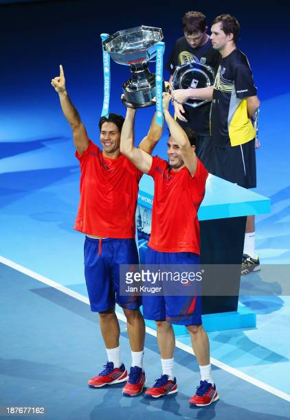 Fernando Verdasco and David Marrero of Spain celebrate with the trophy after victory in their men's doubles final match against Bob and Mike Bryan of...