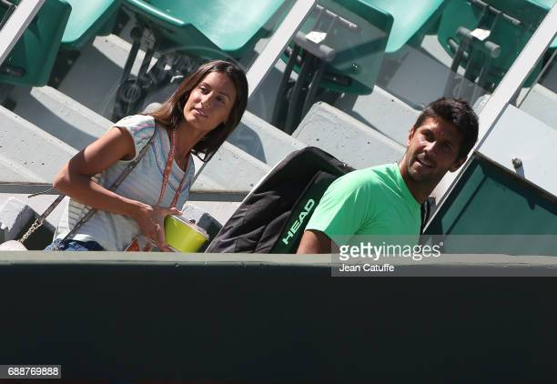 Fernando Verdasco of Spain and Ana Boyer Preysler look at Novak Djokovic's practice on Court Central two days ahead of the start of 2017 French Open...