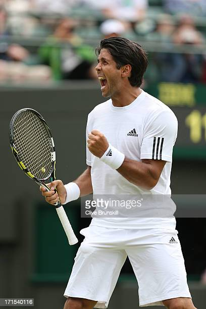 Fernando Verdasco of Spain celebrates match point during his Gentlemen's Singles second round match against Julien Benneteau of France on day three...