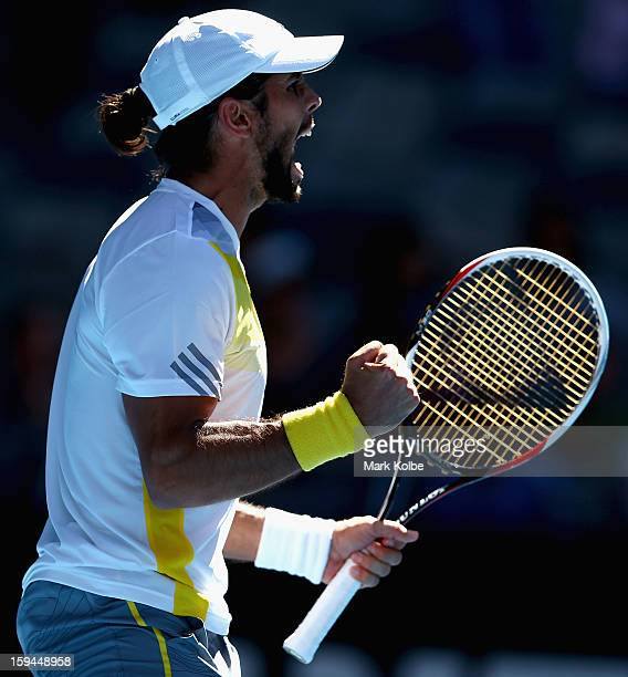 Fernando Verdasco of Spain celebrates winning match point in his first round match against David Goffin of Belgium during day one of the 2013...