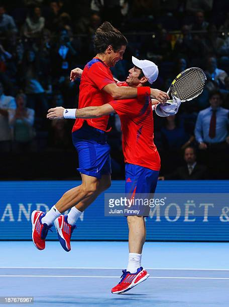 Fernando Verdasco of Spain celebrates winning match point with partner David Marrero in their men's doubles final match against Bob and Mike Bryan of...