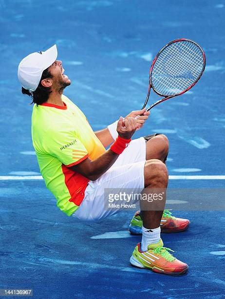 Fernando Verdasco of Spain collapses onto the blue clay having beaten Rafael Nadal of Spain in the 4th round of the Mutua Madrilena Madrid Open at...