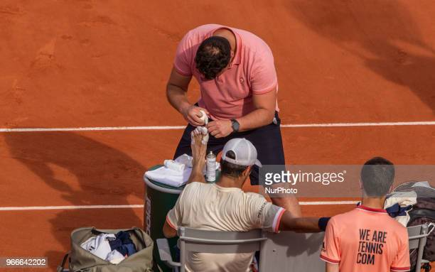 Fernando Verdasco of Spain get a medical treatment during the fourth round at Roland Garros Grand Slam Tournament Day 8 on June 03 2018 in Paris...