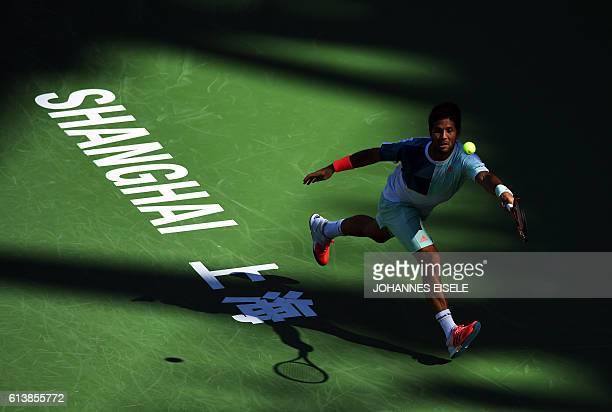 Fernando Verdasco of Spain hits a return against Lucas Pouille of France during their men's singles match at the Shanghai Masters tennis tournament...