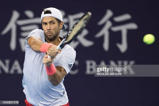 Fernando verdasco of Spain hits a return during his men's singles second round match against Nikoloz Basilashvili of Georgia at the China Open tennis...