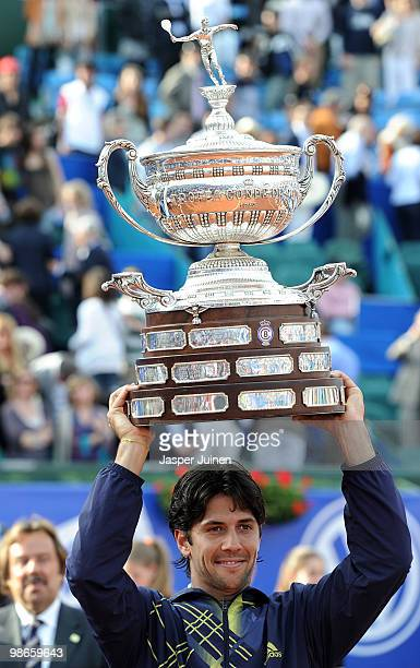 Fernando Verdasco of Spain holds the winners trophy aloft after winning the final match against Robin Soderling of Sweden on day seven of the ATP 500...