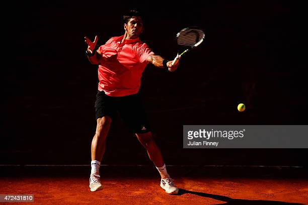 Fernando Verdasco of Spain in action against David Ferrer of Spain during day six of the Mutua Madrid Open tennis tournament at the Caja Magica on...