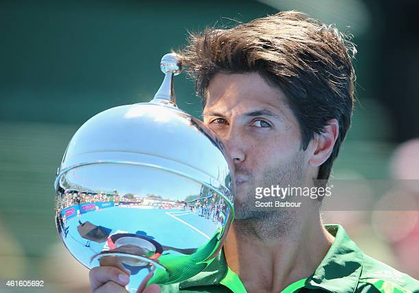 Fernando Verdasco of Spain kisses the trophy after defeating Alexandr Dolgopolov of Ukraine in the Championship Match to win the tournament during...