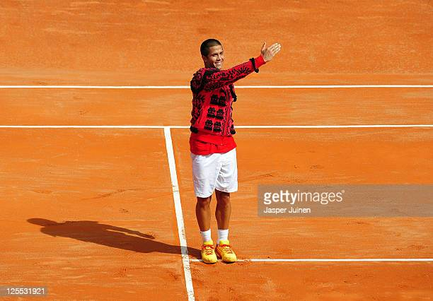 Fernando Verdasco of Spain performs 'una vuelta al ruedo' greeting the crowd in bullfighting style after winning his match against Richard Gasquet of...