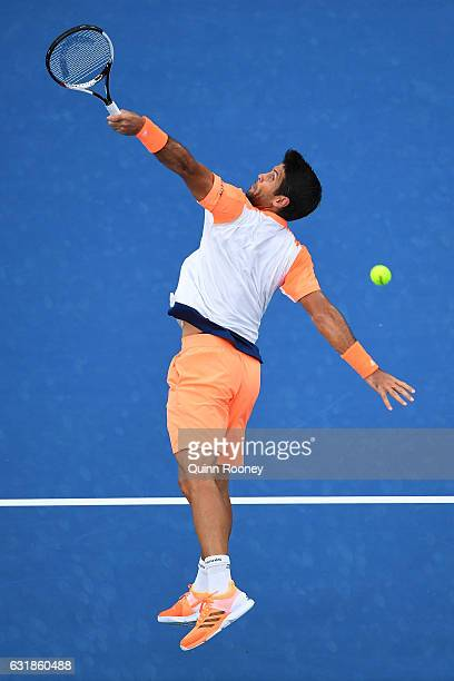Fernando Verdasco of Spain plays a backhand in his first round match against Novak Djokovic of Serbia on day two of the 2017 Australian Open at...