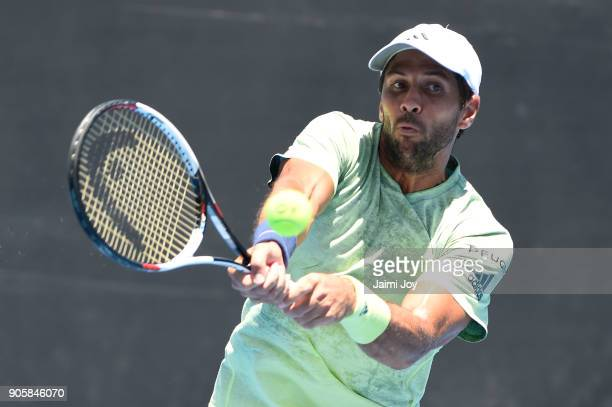 Fernando Verdasco of Spain plays a backhand in his first round men's doubles match with Ivan Dodig of Croatia against Steve Johnson of the United...