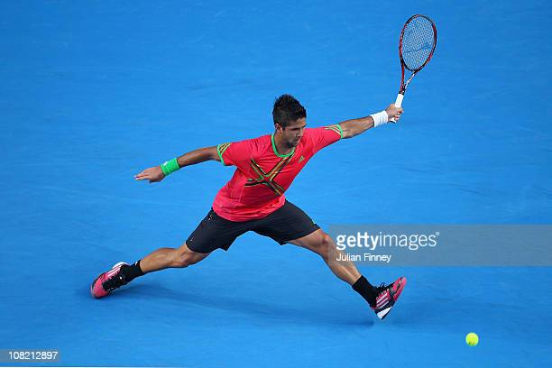 Fernando Verdasco of Spain plays a forehand in his third round match against Kei Nishikori of Japan during day five of the 2011 Australian Open at...