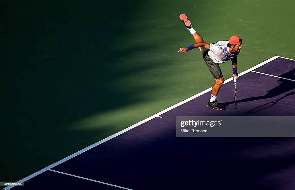Fernando Verdasco of Spain plays a match against Rafael Nadal of Spain during Day 7 of the Miami Open presented by Itau at Crandon Park Tennis Center on March 29, 2015 in Key Biscayne, Florida.