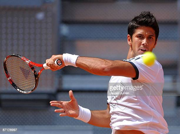 Fernando Verdasco of Spain plays the ball to his fellow countryman Juan Carlos Ferrero in his first round match during the Madrid Open tennis...