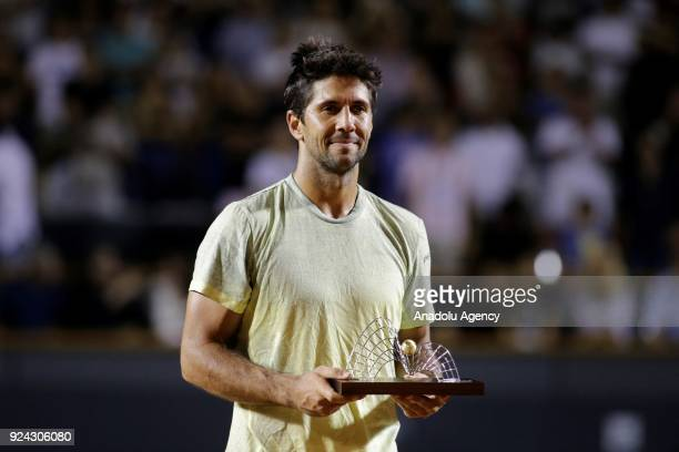 Fernando Verdasco of Spain poses with his trophy after coming in second place in Rio Open Tennis Tournament final match against Diego Schwartzman of...