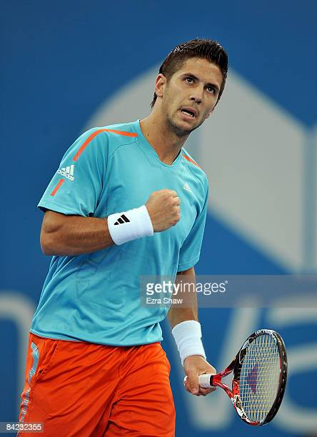 Fernando Verdasco of Spain pumps his fist after winning the first set of his semifinal match against PaulHenri Mathieu of France on day seven of the...