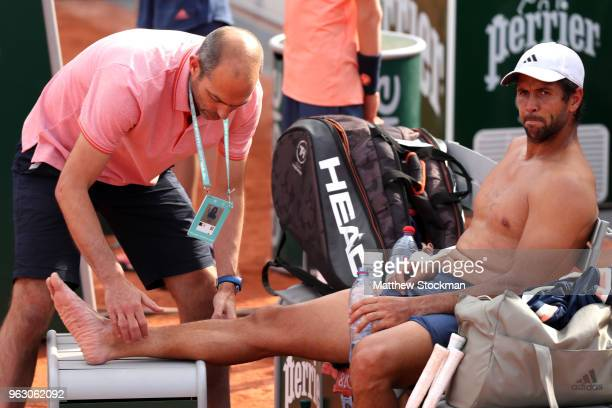 Fernando Verdasco of Spain reacts to an injury during the men singles first round match against Yoshihito Nishioka of Japan during day one of the...